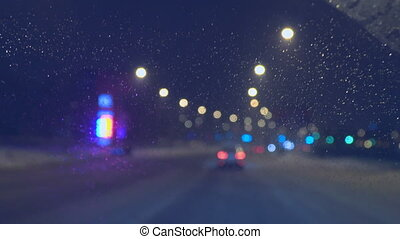 Drops on the windshield of the car at night