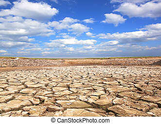 Drought blue sky - Drought land against a blue sky with...