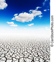 drought earth and blue sky with clouds
