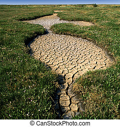 Drought hits - Cracked and dry earth. Formed after a period ...