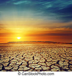 drought land and sunset over it