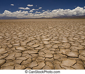 Drought - Large field of baked earth after a long drought.