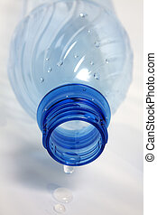 drought - last drop of empty water bottle on white ...