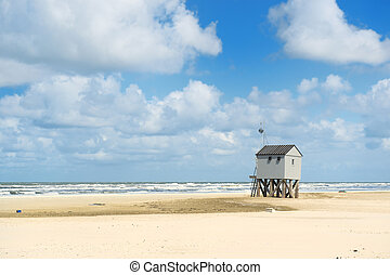 Drowning house at the beach from Dutch wadden island...