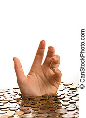 Drowning in debt concept - woman hands reaching up from...