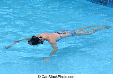 Drowning woman in a swimming pool. Concept photo . copyspace