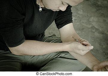 drug addict man with syringe in action