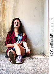 Drug-addicted girl who is crying with heroin syringe