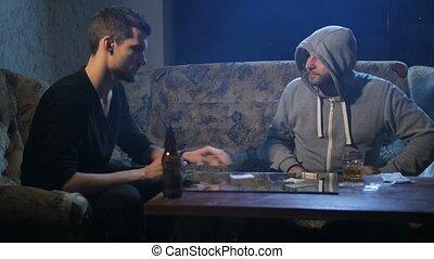 Drug dealer selling cocaine to addict indoors - Drug pusher...