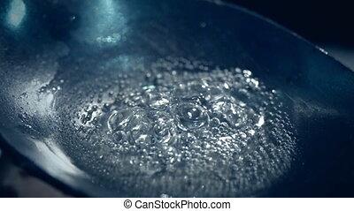 Drug heroin boiling, in spoon before addict - Drug heroin is...