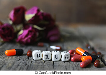 drug pill on wooden table concept addiction