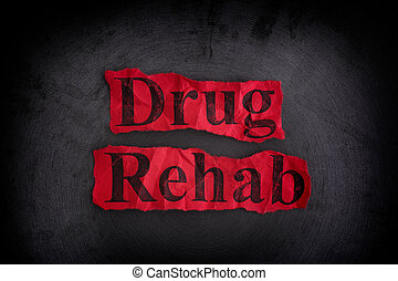 Drug Rehab Concept - Torn crumpled pieces of paper with the...