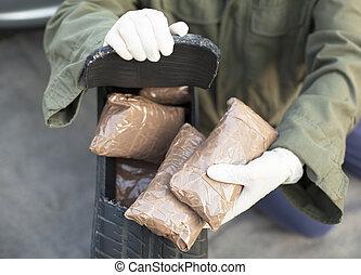 Drug smuggling - Drug bundles found in spare tire