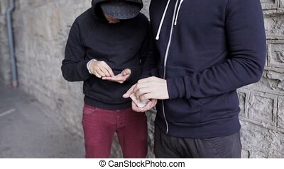 addict buying dose from drug dealer on street - drug...
