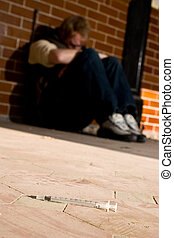 Drug use - drug using man passed out on the floor with...