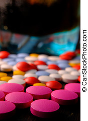 Drugs and alcohol on table, close up