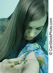 Drugs and needles - poison in hands - Drugs - young woman...