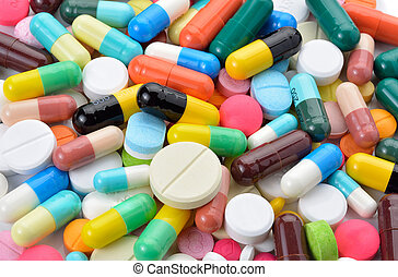 drugs capsules and pills on white background