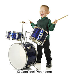 Drum Happy - An adorable preschooler delighted to be playing...