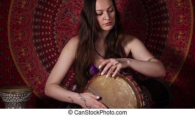 Drum improvisation - Young Caucasian woman playing drum...