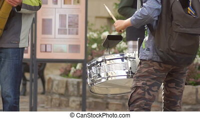 Drum music street band - Street musician plays the drums