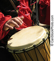 drum player - hand playing a drum