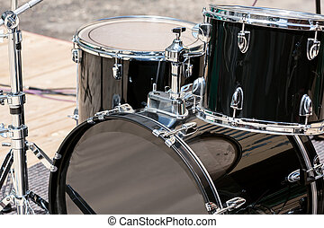 Drum set on stage - Set of black drums on stage, ready for...