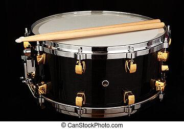 drum - close up drum with drumsticks on black background