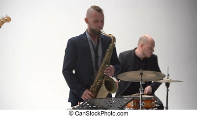 Drummer and Sax play jazz band