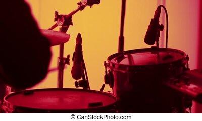 Drummer at concert in red light