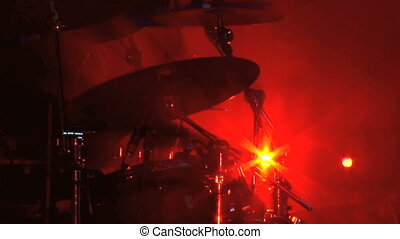 Cymbals being played by rock drummer at a rock concert.