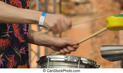Drummer hand with drumstick. Close up
