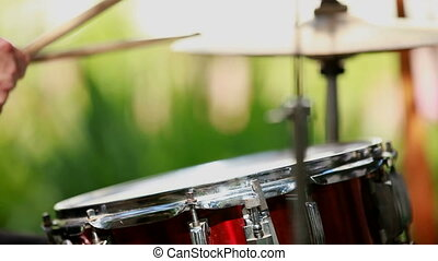 Drummer drumming - Drummer beats the drum in the rhythm. Two...