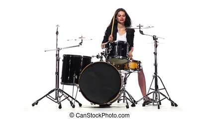 Drummer girl starts playing energetic music, she smiles. White background. Slow motion