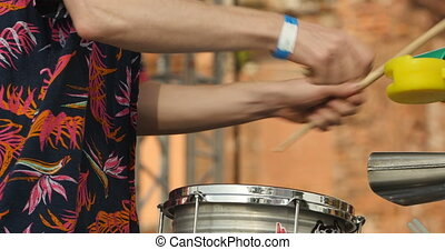Drummer hand with drumstick close to