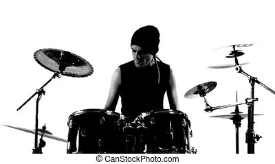 Drummer in a studio. Black and white video.