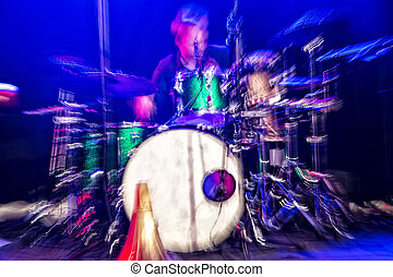 Drummer in action, shot with intentional camera movement