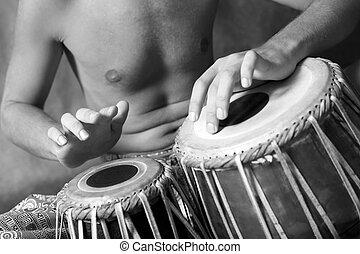 Drummer - Man playing the nigerian drum in studio