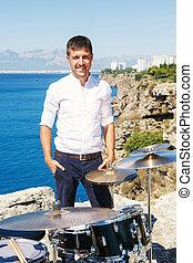 Drummer near the sea