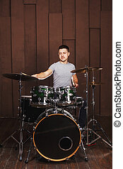 Drummer on a brown background
