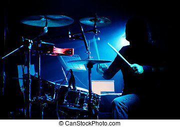 Drummer on a gig - Drummer playing drums in concert with...