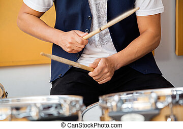 Drummer Performing In Recording Studio