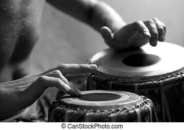 Drummer - Man playing the djembe (nigerian drum) in studio