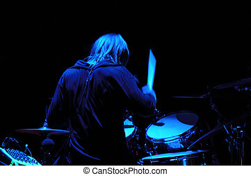 Drummer playing.