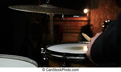 Drummer Playing Drums and Cymbals in Music Studio