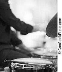 Drummer playing drumset in wedding party reception