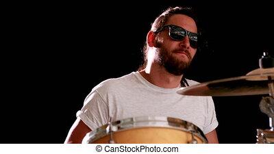 Drummer playing his drum kit