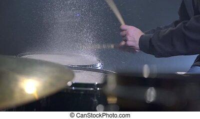 Drummer playing in modern music studio