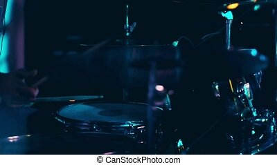 Professional drummer playing on live concert, closeup