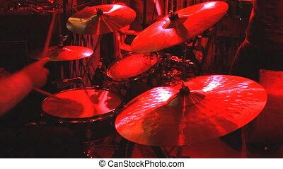 drummer playing on drum set